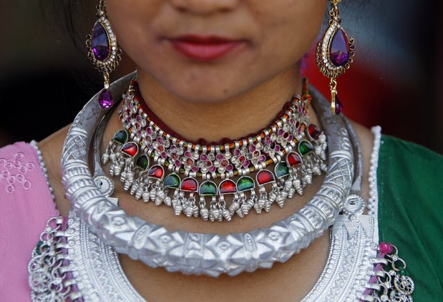 A Nepalese Tharu ethnic community woman wearing traditional ornaments attends the Maghi festival celebrations, or the New Year of the Tharu community in Kathmandu, Nepal, Thursday, January 15, 2015. Tharus who have their distinctive culture are one the major ethnic groups settled in 23 districts across the Terai Belt of Nepal. (Photo by Niranjan Shrestha/AP Photo)