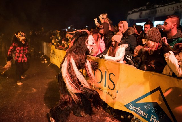 People dressed as the Krampus perform during the 9th Krampus meeting show in Serfaus, Tyrol, Austria, 12 November 2016. (Photo by Christian Bruna/EPA)