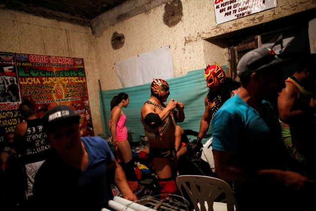 Wrestlers are seen backstage before an extreme wrestling fight at a temporary wrestling ring in a car wash in Tulancingo Hidalgo, Mexico October 8, 2016. (Photo by Carlos Jasso/Reuters)
