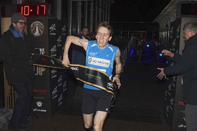 Christian Riedl of Germany crosses the finish line on the 86th floor as he wins the Men's Elite class during the 38th Annual Empire State Building Run-Up in the Manhattan borough of New York February 4, 2015. Riedl finished in a time of 10:16. (Photo by Carlo Allegri/Reuters)