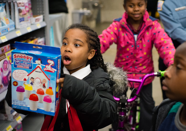 Haleigh Holman, 7, looks at a snoopy snow cone machine toy. The Metropolitan Police Department teamed up with Walmart for the annual Shop with a Cop shopping event on December 10, 2015 at Walmart's Fort Totten Store in Washington, DC. (Photo by Sarah L. Voisin/The Washington Post)