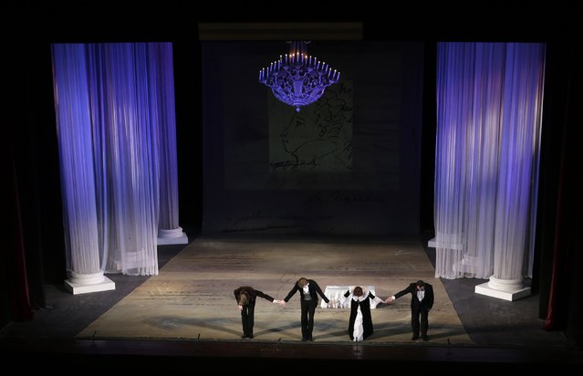 Actors with the Donbass Opera Theatre take their bow after a performance of Eugene Onegin in Donetsk, Ukraine, Saturday, February 7, 2015. (Photo by Petr David Josek/AP Photo)