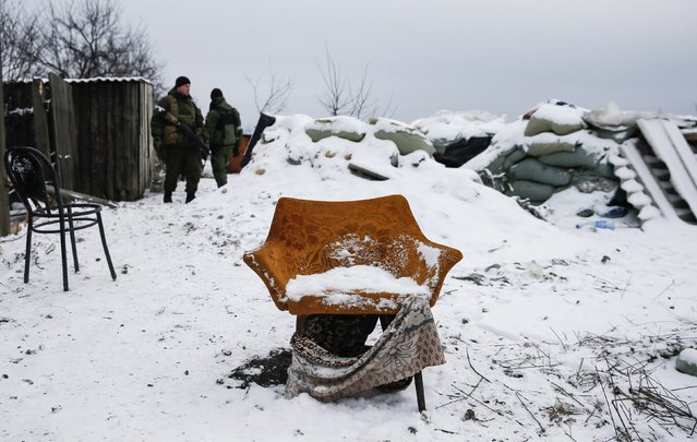 Pro-Russian separatists stand behind an armchair at a checkpoint used by Ukrainian government troops on the outskirts of Vuhlehirsk, eastern Ukraine February 10, 2015. (Photo by Maxim Shemetov/Reuters)