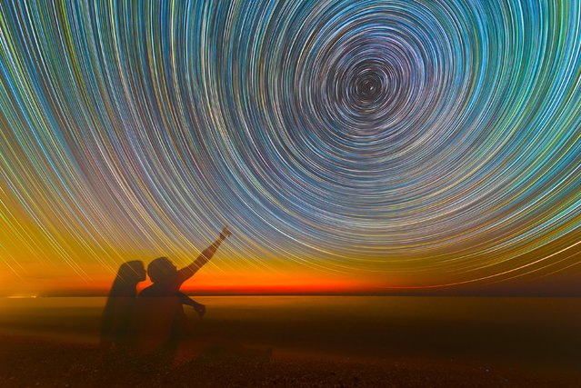 Vibrate, colorful star trails over the sea. (Photo by Evgeniy Zaytsev/Caters News)
