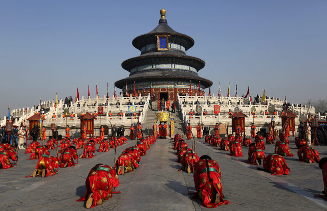 Chinese performers in Qing dynasty imperial costumes perform during a rehearsal of a recreation of the Sacrifice to Heaven ritual ahead of the Chinese Lunar New Year, or Spring Festival at the Temple of Heaven Beijing, China, 13 February 2015. China is celebrating the country's main annual holiday, the Spring Festival or Lunar New Year of the goat according to the traditional twelve year zodiac which begins on 19 February 2015.  (Photo by How Hwee Young/EPA)
