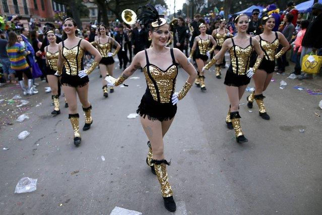 Revellers make their way down St. Charles Avenue during a Mardi Gras parade in New Orleans, Louisiana February 15, 2015. (Photo by Jonathan Bachman/Reuters)