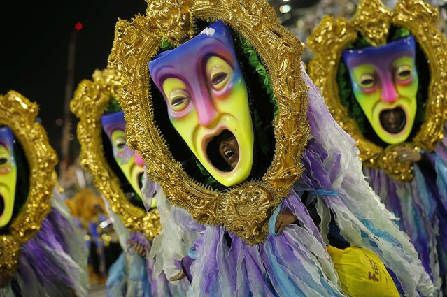 Revelers from the Uniao da Ilha samba school participate in the annual carnival parade in Rio de Janeiro's Sambadrome, February 17, 2015. (Photo by Sergio Moraes/Reuters)