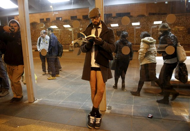 """An Israeli man waits without his pants on for travel on the light rail as he takes part in the third annual """"No pants subway ride"""" event in Jerusalem January 10, 2016. Beginning in 2002 in New York by Improv Everywhere, this self described """"prank collective"""" has spread to dozens of cities worldwide, with thousands of participants who aim to put a smile upon the faces of their fellow passengers. (Photo by Ronen Zvulun/Reuters)"""