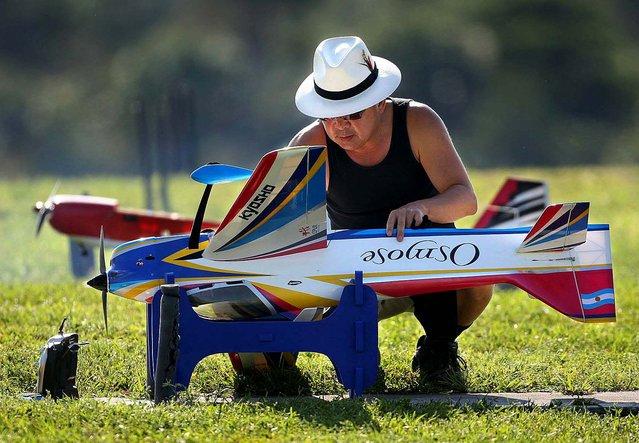 Julius Lee prepares a Kyosho Acrobatic Osmose plane. (Photo by Bill Ingram/The Palm Beach Post)
