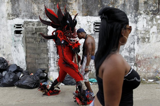 """A man, dressed up as the devil, performs during the """"Diablos y Congos"""" (Devils and the Africans) festival in Nombre de Dios, Colon Province, February 18, 2015. (Photo by Carlos Jasso/Reuters)"""