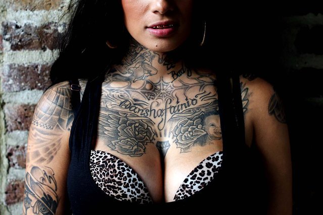 Bugz Bonniie displays some of her tattoos. (Photo by Oli Scarff/Getty Images)