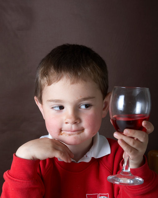 Four year old boy with red wine. (Photo by tirc83/Getty Images)