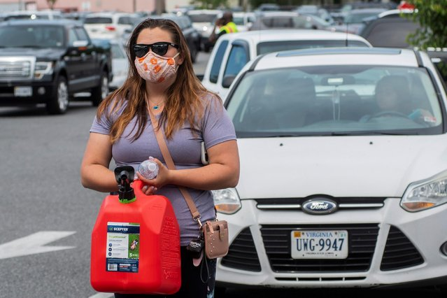 Elizabeth Dragomir had to stand in a line of vehicles waiting for gas at Costco after a cyberattack crippled the biggest fuel pipeline in the country, run by Colonial Pipeline. Dragomir's car ran out of gas in the parking lot, in Norfolk, Virginia, U.S., May 11, 2021. (Photo by Jay Paul/Reuters)