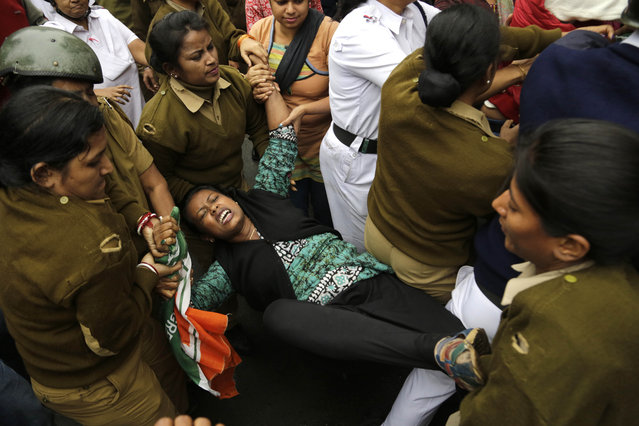 Indian police women detain an activist of India's opposition Congress party during  a protest in Kolkata, India, Wednesday, January 20, 2016. The activists were protesting the death of an Indian student who, along with 4 others, was barred from using some facilities at his university in the southern tech-hub of Hyderabad. The protesters accused Hyderabad University's vice chancellor along with two federal ministers of unfairly demanding punishment for the five lower-caste students after they clashed last year with a group of students supporting the governing Hindu nationalist party. (Photo by Bikas Das/AP Photo)