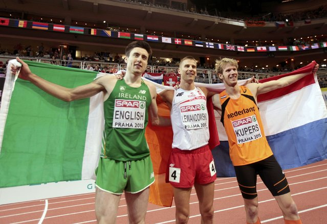Winner Marcin Lewandowski of Poland, second placed Mark English of Ireland (L) and third placed Thijmen Kupers of Netherlands (R) celebrate after their men's 800 metres final during the European Indoor Championships in Prague March 8, 2015. REUTERS/David W Cerny (CZECH REPUBLIC  - Tags: SPORT ATHLETICS)