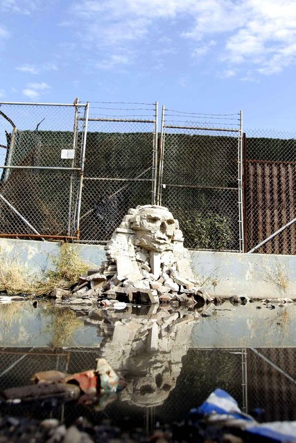A 1/36 scale replica of the great Sphinx of Giza made from smashed cinder blocks, created by Banksy, stands in Queens on October 22, 2013. (Photo by John Angelillo/Newscom/SIPA Press)