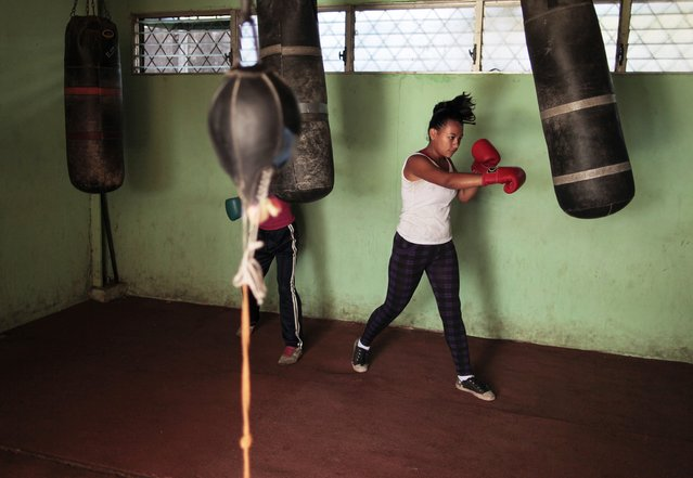 A woman trains with a punch bag at the National Institute of Sport in Managua March 4, 2015. (Photo by Oswaldo Rivas/Reuters)