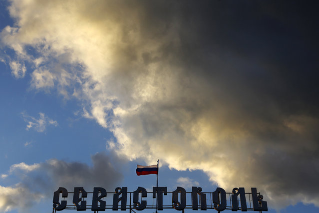 "A Russian flag flutters over the ""Sevastopol"" hotel in Sevastopol March 29, 2014. (Photo by Yannis Behrakis/Reuters)"
