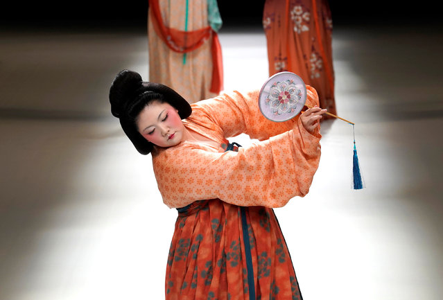 A woman dressed in a Tang-dynasty costume performs at a show by designer Chu Yan at China Fashion Week in Beijing, China, October 30, 2018. (Photo by Jason Lee/Reuters)