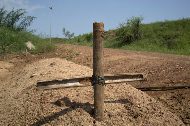 SOUTH SUDAN: Graves of unidentified people killed during recent fighting are seen in Juba, South Sudan, July 22, 2016. (Photo by Adriane Ohanesian/Reuters)
