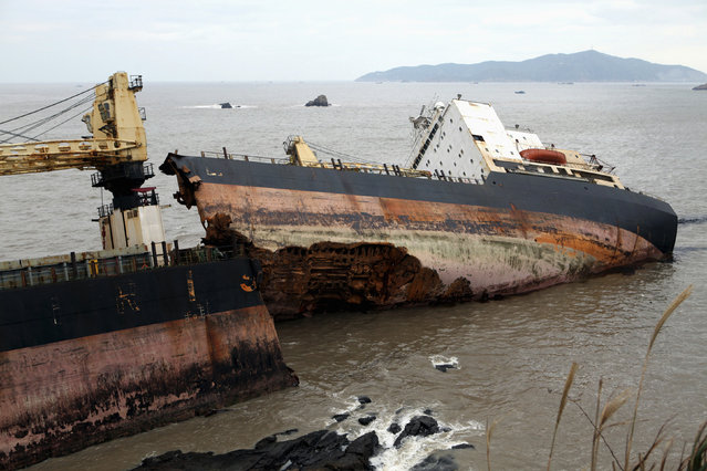 A general view shows Iranian container ship, Zoorik, which broke into two parts by strong waves after running aground off the coast near Zhoushan, Zhejiang province, China, November 3, 2009. Zoorik was stranded at the estuary of the Yangtze River. (Photo by Reuters/China Daily)