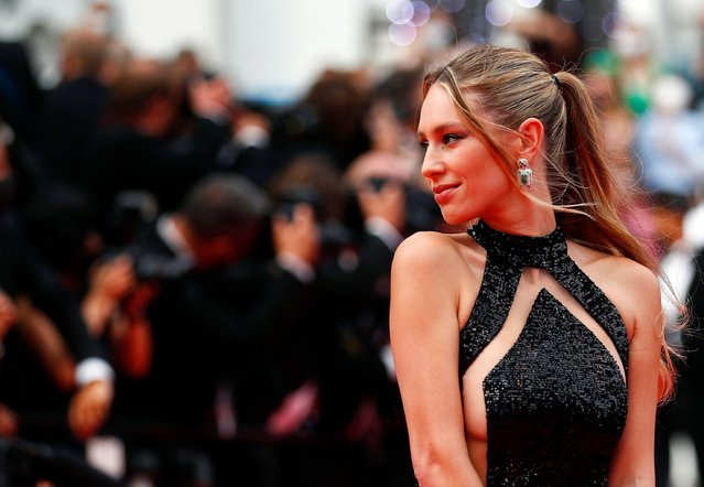 """US actress Dylan Penn arrives for the screening of the film """"The French Dispatch"""" at the 74th edition of the Cannes Film Festival in Cannes, southern France, on July 12, 2021. (Photo by Johanna Geron/Reuters)"""