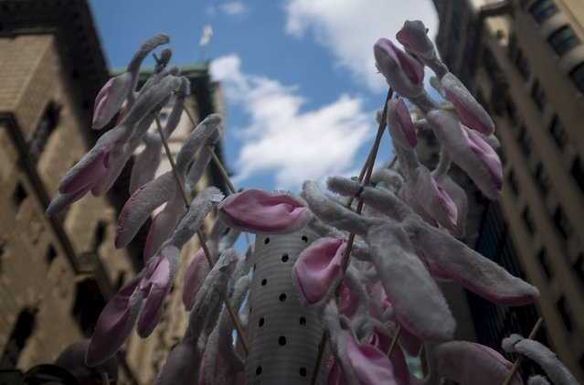Bunny ears for sale are displayed at the Easter Parade and Bonnet Festival along 5th Avenue in New York City April 5, 2015. (Photo by Eric Thayer/Reuters)