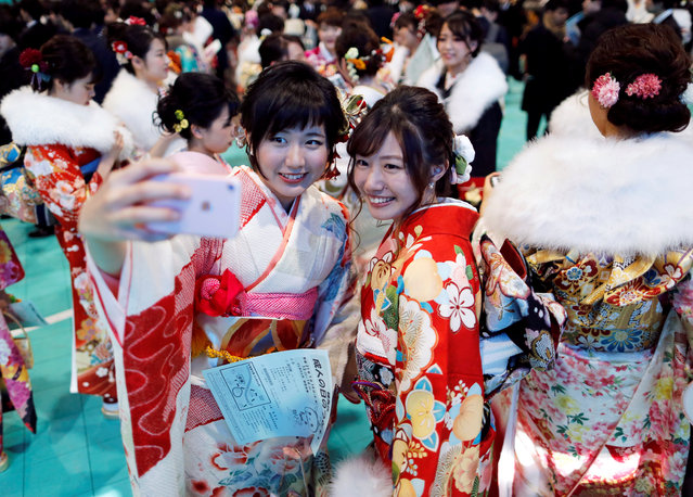 Japanese women wearing kimonos take a selfie as they attend their Coming of Age Day celebration ceremony at Toshimaen amusement park in Tokyo, Japan on January 14, 2019. (Photo by Issei Kato/Reuters)