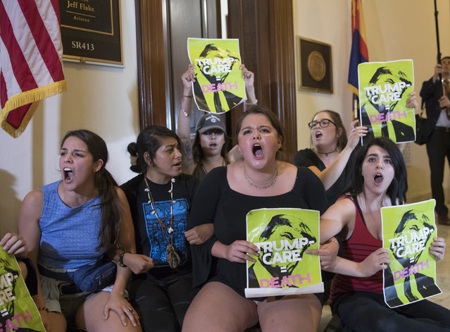 In this July 10, 2017, file photo, activists protest against the Republican health care bill outside the offices of Sen. Jeff Flake, R-Ariz., and Sen. Ted Cruz, R-Texas on Capitol Hill in Washington. About 120,000 Arizona residents who receive Medicaid benefits will have to get a job, do community service or temporarily lose health coverage. The Centers for Medicare and Medicaid Services approved the state's plan Friday, Jan.18, 2019. The Trump administration has urged states to consider changes to their Medicaid programs to encourage work and independence. Others say it unfairly targets the working class. (Photo by J. Scott Applewhite/AP Photo)