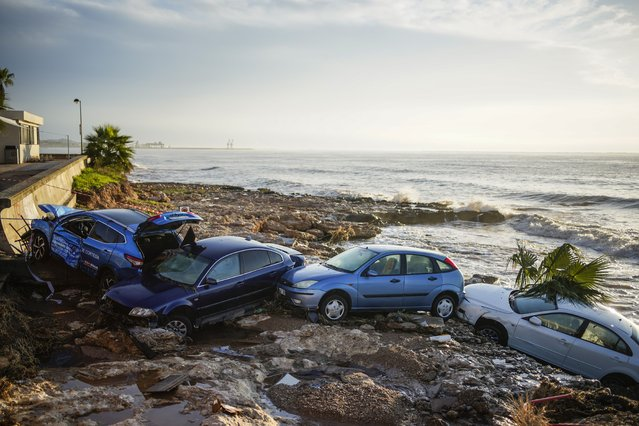 Wrecked cars stuck in the shore of the seaside town of Alcanar, in northeastern Spain, Thursday, September 2, 2021. A downpour Wednesday created flash floods that swept cars down streets in the Catalan town of Alcanar. Most of mainland Spain is under alert for heavy rains. (Photo by Joan Mateu Parra/AP Photo)