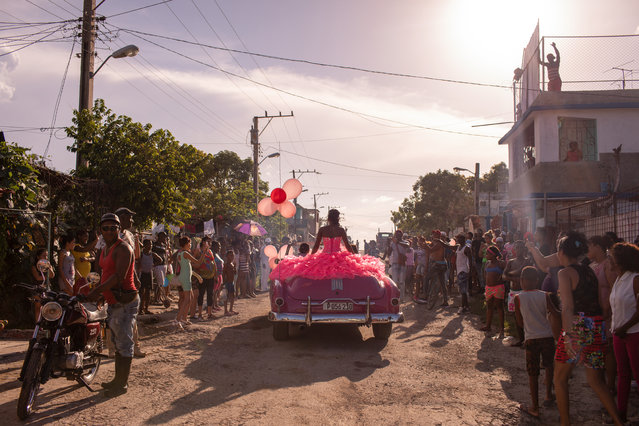 Contemporary issues single nominee: The Cubanitas, by Diana Markosian. Pura rides around her neighbourhood in a pink 1950s convertible, as the community gathers to celebrate her 15th birthday, in Havana, Cuba. (Photo by Diana Markosian/Magnum Photos/World Press Photo 2019)