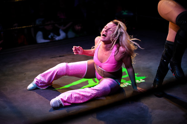 Wrestlers perform during an all-female wrestling event on International Women's Day at the Resistance Gallery in Bethnal Green on March 8, 2019 in London, England. EVE is an all-female professional wrestling show, founded in 2010 by Emily Read and her husband Dann. The night features costumed performers wrestling against one another in rehearsed contests. (Photo by Jack Taylor/Getty Images)