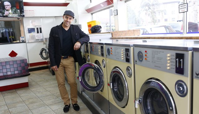 "Shahram, 39, poses for a photograph at his workplace, Prestige Dry Cleaning and Launderette, in the London constituency of Brent Central, Britain, April 3, 2015. Shahram, who was born in Iran, said: ""I don't like Ed Milliband but I will still vote Labour as I think the economy was better when Labour were in charge"". (Photo by Eddie Keogh/Reuters)"
