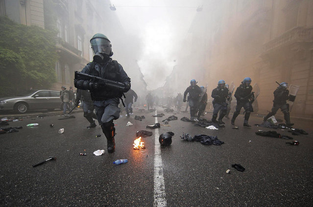 Riot police advances during clashes following a protest against the Milan's Expo 2015 Universal Exposition in Milan, Italy, 01 May 2015. Hundreds of people protested against the Expo which opened the same day and runs for six months. (Photo by Massimo Percossi/EPA)