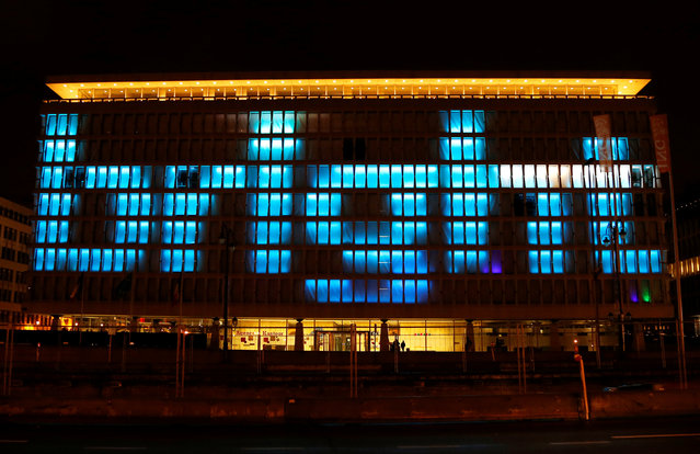"""An artistic light installation reading """"bright"""" is pictured on the facade of an office building during the Bright Brussels Festival in Brussels, Belgium February 4, 2017. (Photo by Francois Lenoir/Reuters)"""