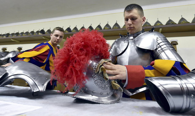 New Vatican Swiss Guards wear their uniforms and armors prior to a swearing-in ceremony, at the Vatican, Wednesday, May 6, 2015. (Photo by Ettore Ferrari/AP Photo/Pool Photo)