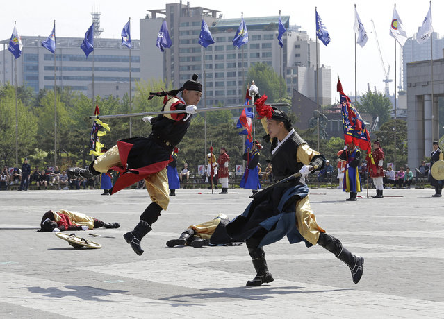 South Korean honor guard soldiers wearing traditional military uniforms demonstrate their martial arts during a weekly performance at Korea War Memorial Museum in Seoul, South Korea, Friday, May 3, 2019. The honor guard's performance resumed last Friday, April 26, as it was suspended in cold weather. Their performances in the honor guard ceremony attract foreign tourists and local visitors every year. (Photo by Ahn Young-joon/AP Photo)
