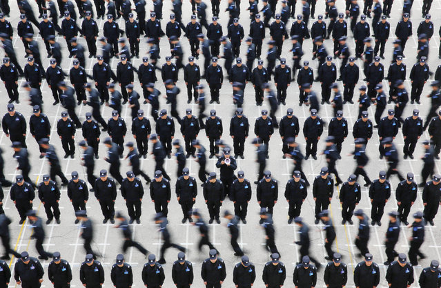 Police officers of the China Immigration Inspection take part in a training session in Shenyang, Liaoning province, China on May 20, 2019. (Photo by Reuters/China Stringer Network)