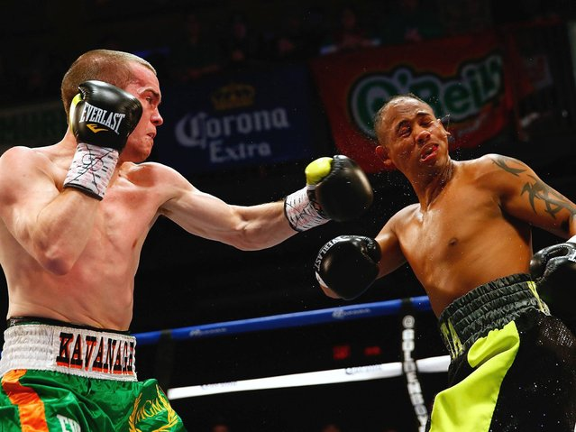 Jamie Kavanagh punches Andres Navarro during the junior welterweight fight at House of Blues Boston on March 17, 2014 in Boston, Massachusetts. (Photo by Jared Wickerham/Getty Images)