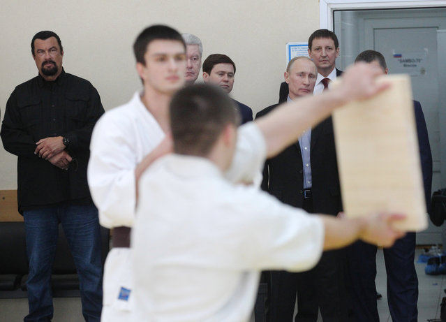U.S. actor Steven Seagal and Russian President Vladimir Putin are seen visiting Sambo-70, a Russian martial art and combat sport school, March 13, 2013 in Moscow, Russia. (Photo by Sasha Mordovets/Getty Images)