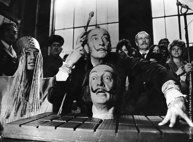Spanish surrealist painter Salvador Dali with a model of his own head, at a press conference in Paris, 1973
