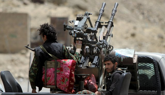 Houthi militants ride in a patrol truck in Sanaa May 2, 2015. (Photo by Mohamed al-Sayaghi/Reuters)