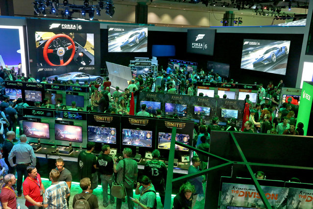 E3 2015 attendees interact with newly announced games and experiences at the Xbox booth at E3 in Los Angeles on Tuesday, June 16, 2015. (Photo by Casey Rodgers/Invision for Microsoft/AP Images)