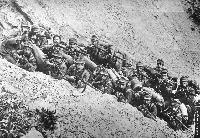 1915:  Italian soldiers in a trench on a mountain side, ready for action