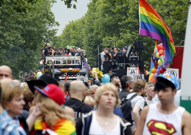 People participate on trucks at the annual Christopher Street Day parade on Kurfuerstendamm in Berlin, Germany, June 27, 2015. (Photo by Fabrizio Bensch/Reuters)