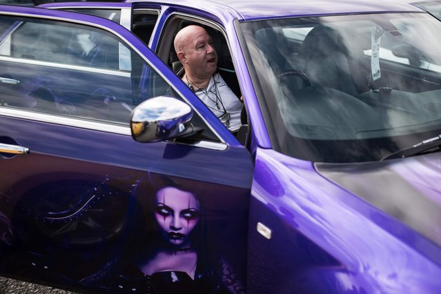 A modified vehicle enthusiast relaxes in his car at The Fast Show performance car event held at the Santa Pod Raceway near Wellingborough, central England on April 2, 2017. (Photo by Oli Scarff/AFP Photo)