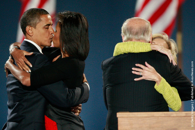 U.S. President elect Barack Obama (L) kisses his wife Michelle as Vice-President elect Joe Biden (right) embraces his wife Jill