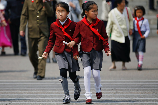 Girls cross the street in Pyongyang, North Korea April 16, 2017. (Photo by Damir Sagolj/Reuters)