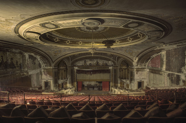 "A run down theater in Connecticut. ""It was sunset when we visited and the light in the entrance hall was tricky at best. Despite that, they fitted the theme of abandoned America so well"". (Photo by Daniel Barter/Caters News)"