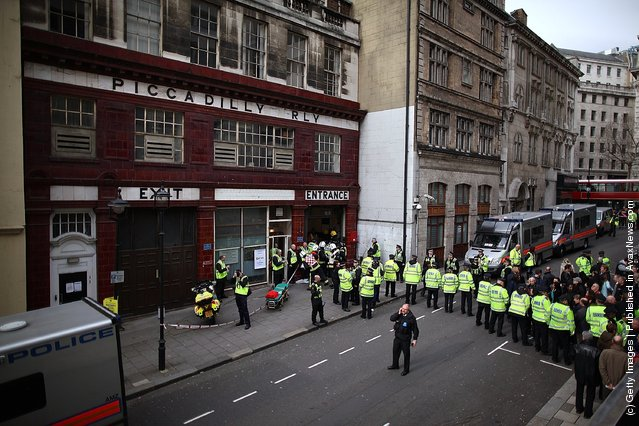 Police evacuate passengers during an emergency services exercise at the disused Aldwych underground station in London